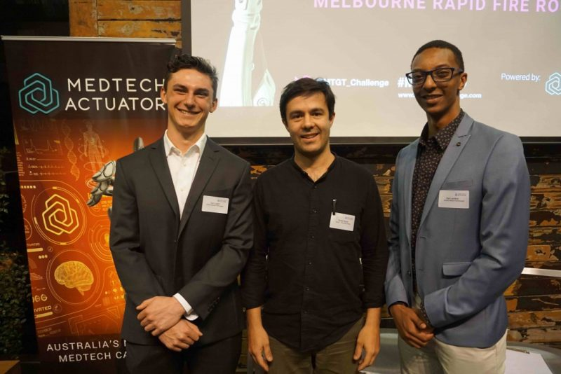 Photo of Tom Logan (left) and Zak Landers (right) from Wickens Medical Technologies and new mentor Brody Payne (center) from Outerspace Design at Melbourne Rapid Fire Rounds 2019.