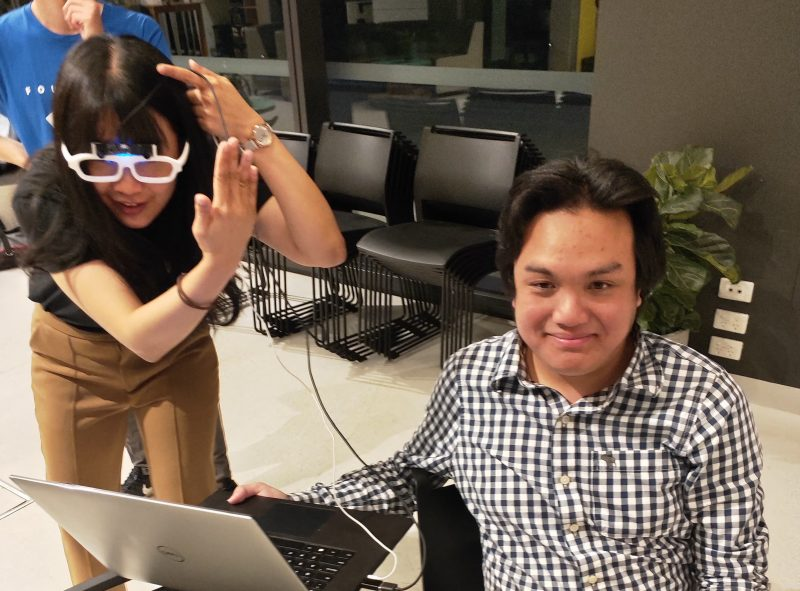Photo of people trying out the Soundsense technology.