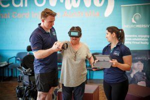 Neuromersiv team with neurorehabilitation patient and VR technology.